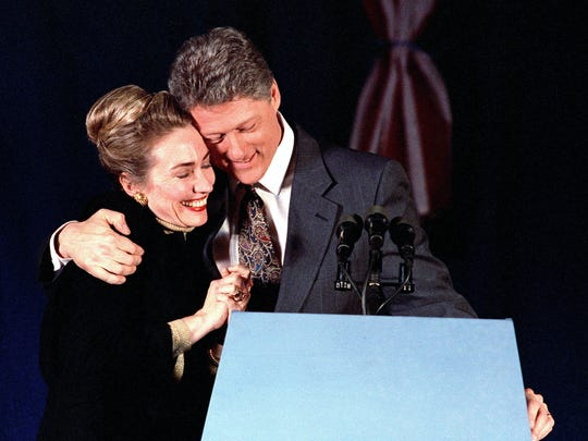 The Clintons embrace during a party at the Merrimack Inn in Merrimack, N.H., in this Feb. 18, 1992, file photo.