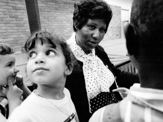 Aretha Franklin meets fans after reading to them at