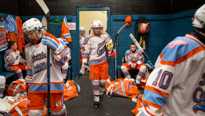 Detroit Little Caesars players walk into the locker room during a Silver Stick PeeWee AAA hockey game Saturday, Jan. 10, 2015 at McMorran Pavilion.