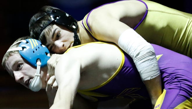 Two Rivers' two-time state champion Paul Bianchi, top, wins over Sheboygan Falls' Brandon Hill at 34 seconds of the match during the dual meet on Thursday, Dec. 17 in Two Rivers. The Raiders defeated the Falcons 40-20.