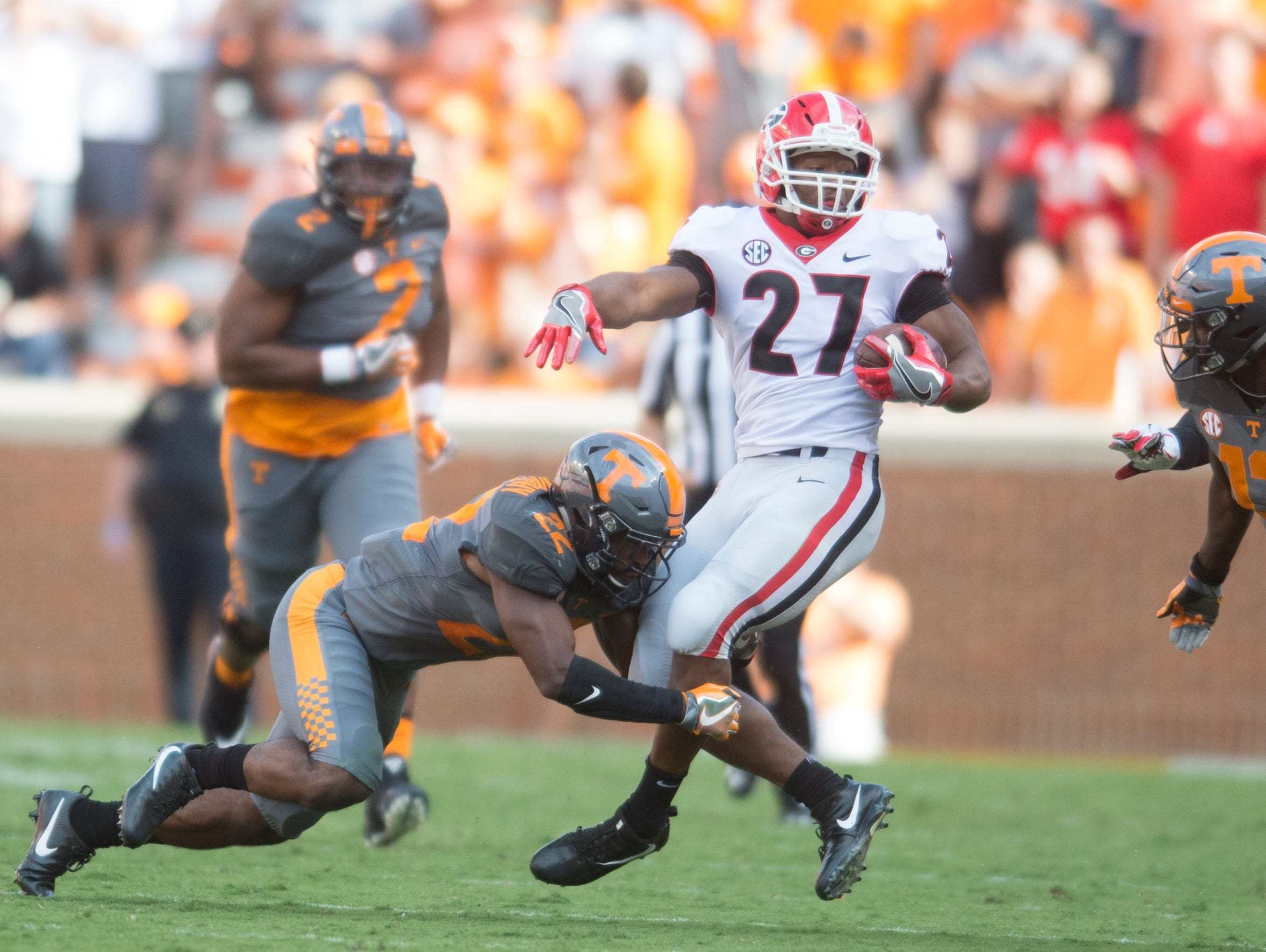 Georgia running back Nick Chubb (27) is tackled by Tennessee defensive back Micah Abernathy (22) on Sept. 30, 2017.