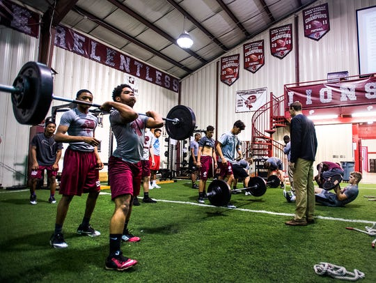 Prattville High School football players during weight