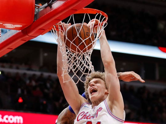Apr 11, 2018; Chicago, IL, USA; Chicago Bulls forward Lauri Markkanen (24) dunks the ball against Detroit Pistons forward Eric Moreland (24) during the first half at United Center. Mandatory Credit: Kamil Krzaczynski-USA TODAY Sports