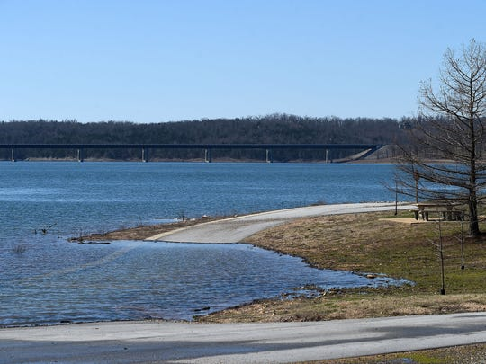 High water on Norfork Lake has covered a road at Bidwell Point Park.