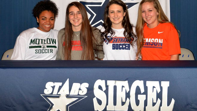 Siegel seniors (l-r): Kayla Moultry, Alexis Louk, Bella Roberts and Ashley Lawson all signed letters of intent to play college soccer Wednesday.