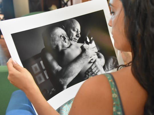 Photographer Nancy Borowick looks at her photograph of her mother and father, at the Guam Museum in Hagåtña on April 20, 2017. Borowick photographed her parents' experience with Stage 4 cancer before they died.