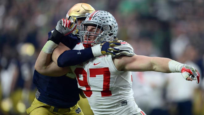 Ohio State defensive lineman Joey Bosa (97) tries to get past a Notre Dame blocker in the 2016 Fiesta Bowl.