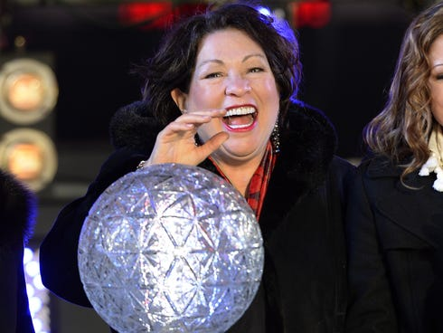 Supreme Court Justice Sonia Maria Sotomayor presses the countdown ball as thousands of revelers gather in New York's Times Square.