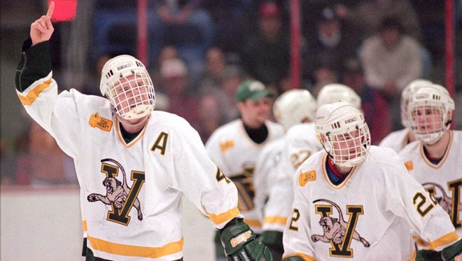 Vermont's Steve McKell, left, and teammates celebrate their NCAA Division I East Regional win over Lake Superior State in Albany, N.Y. in 1996.