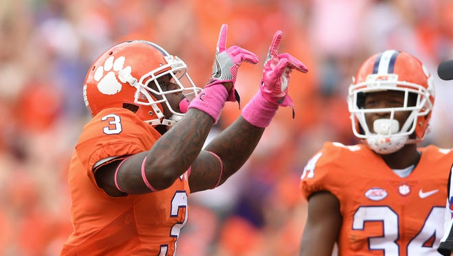 Clemson wide receiver Artavis Scott (3) reacts after catching a TD in overtime against North Carolina State on Saturday, October 15, 2016 at Clemson's Memorial Stadium.