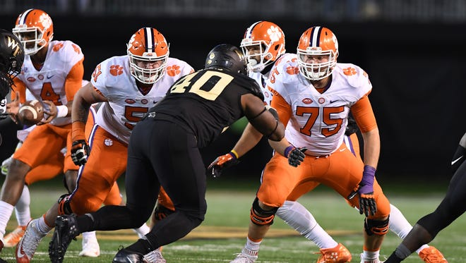 Clemson offensive linemen Taylor Hearn (51) and Mitch Hyatt (75) block Wake Forest defensive tackle Josh Banks during a game at BB&T Field on Nov. 19, 2016.