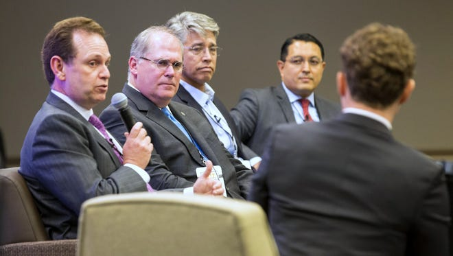Enrique Marroquin, far left, president of Hunt Mexico Inc., says El Paso needs an electric connection to Mexico at the recent U.S.-Mexico Border Summit in El Paso. Others on a summit energy panel, left to right, are Pierce Norton, CEO of One Gas; Terry Spencer, CEO of Oneok Inc., and Guillermo Zuniga, commissioner of the Mexico Energy Regulatory Commission. Patrick Shaefer, executive director of the Hunt Institute for Global Competitiveness at University of Texas at El Paso, back to camera, moderated the discussion.
