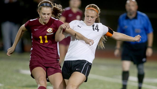 Central Kitsap soccer player Lauren Hudson, right, battles for control against Capitol's Madeline Thompson Tuesday night at Silverdale Stadium.