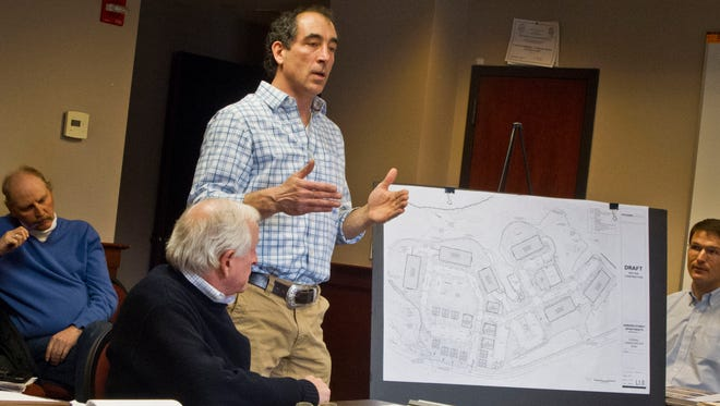 Patrick O'Brien, project manager for S.D. Ireland's proposed residential development on Grove Street in Burlington, presents plans Tuesday to the city's Design Advisory Board.Also pictured, from left: S.D. Ireland President Scott Ireland, project architect Michael Dugan and Scott Gustin, a senior planner with the Burlington Planning and Zoning Department.
