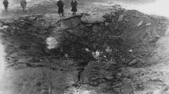 A huge crater was formed from the explosion of nearly 6,000 pounds of dynamite and 8,000 pounds of blasting powder that demolished a powder house located on the Fred Dawley farm east of Sioux Falls in 1936.