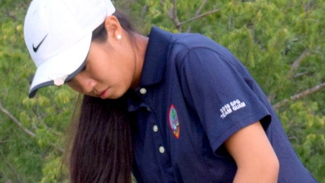 Guam national golf team member Kalina Sunga practices putting at the Royal Port Moresby Golf Club. The golf team completed round one of competition at the Pacific Games on July 15. The Guam women's team was last amoung eight teams after two rounds.