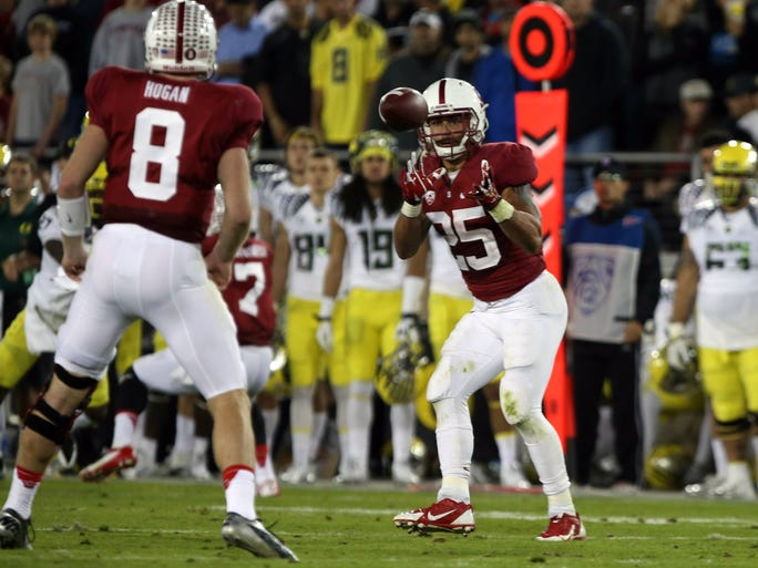 Stanford Cardinal running back Tyler Gaffney receives the ball from quarterback Kevin Hogan against the Oregon Ducks during the second quarter.