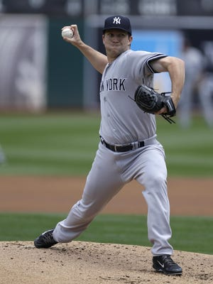 Adam Warren, shown here working against Oakland on Sunday, will remain in the Yankees' rotation when Masahiro Tanaka returns from the disabled list.