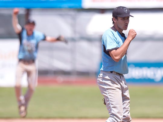 South Burlington pitcher Sam Premsagar exhales after the final out of the Wolves' win in the Division I high school baseball state championship game on Saturday at Centennial Field.