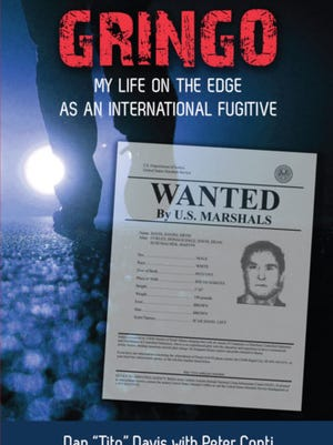 Dan Davis wrote a book with Peter Conti about his fugitive past.