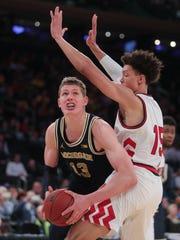 Michigan forward Moritz Wagner scores against Nebraska