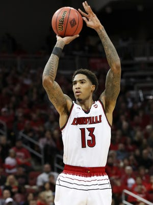 U of L's Ray Spalding (13) shot against Mississippi State during the NIT at the Yum Center in Louisville.    