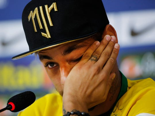 Brazil's Neymar wipes a tear during a press conference at the Granja Comary training center in Teresopolis, Brazil, Thursday, July 10, 2014. The Brazilian soccer star is back on his feet after suffering a broken vertebrae during a World Cup soccer match against Colombia. Brazil will be disputing a third place finish, without its star on Saturday. (AP Photo/Leo Correa)