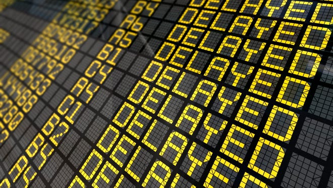Airport board close-up with delayed flights