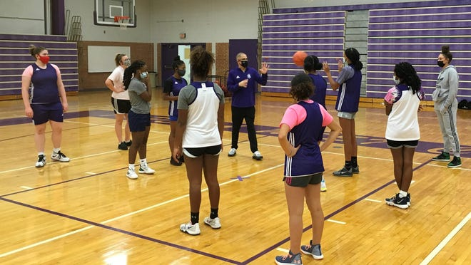 First-year Topeka West girls basketball coach Jeff Skar works with his Chargers during a preseason practice.
