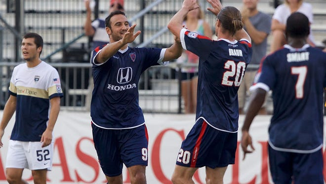 The Indy Eleven's Eamon Zayed and Justin Braun celebrate a goal in their win over Jacksonville. Zayed had a hat trick and Braun scored.
