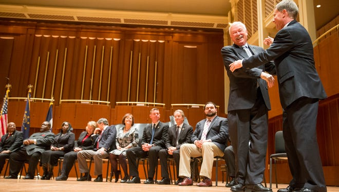 Jack Sandlin of the City-County Council smiles as he is embraced by Joe Hogsett during a combined inauguration for the city's new Mayor Hogsett  and members of the Council at Hilbert Circle Theater in Indianapolis on Jan. 1, 2016.