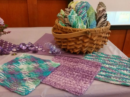 Dishcloths sit on a table at Miriam Mills' 90th birthday celebration. The money she raised by selling them was donated to Heifer International and will provide animals to be used for wool, milk and income for people in underprivileged countries.