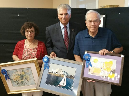 Essex County Executive Joseph N. DiVincenzo Jr., center, congratulates Nutley residents Theresa Ruffo and Anthony J. Andolino Sr. The artists, including Nutley resident Nina R. Del Collo, placed first in the Annual Essex County Senior Citizens Juried Art Show.
