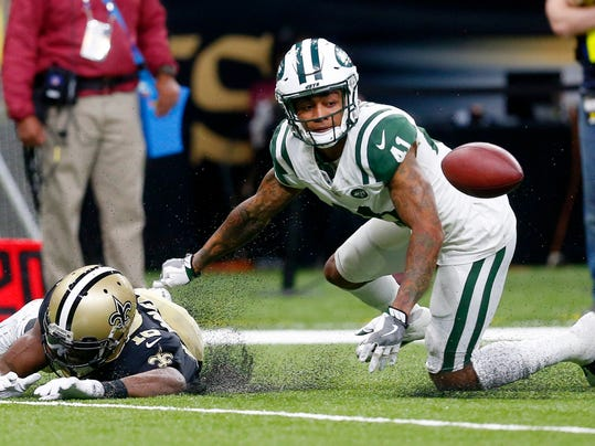 New Orleans Saints wide receiver Brandon Coleman (16) fumbles as he is hit by New York Jets cornerback Buster Skrine (41) in the second half of an NFL football game in New Orleans, Sunday, Dec. 17, 2017. (AP Photo/Butch Dill)