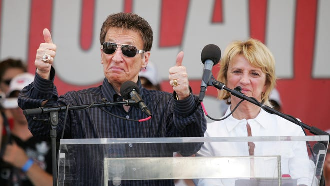 Red Wings owner Mike Ilitch gives a thumbs up to the crowd with his wife, Marian Ilitch at the Red Wings Stanley Cup championship celebration at Hart Plaza in Detroit on June 6, 2008.