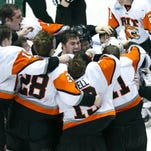 Atlantic Hockey Championship game: RIT vs. Mercyhurst : Center, RIT's Gregory Amlong celebrates with the team their 5-1win over Mercyhurst at the Blue Cross Arena at the War Memorial in Rochester.