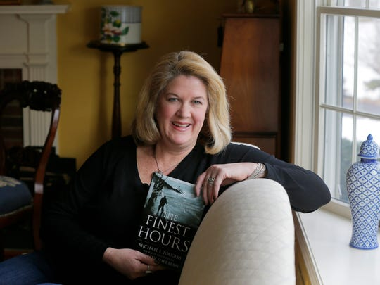 """Fair Haven resident Jann Kelly holds the best-selling book """"The Finest Hours,"""" which has been made into a Disney picture coming out this weekend, in her home in Fair Haven. The movie and book depict a daring Coast Guard rescue in a 1952 storm in which her late father Ed Kiely played a major role."""