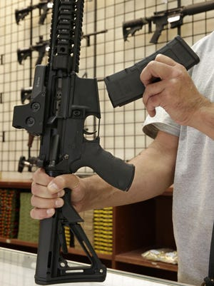 A custom made semiautomatic hunting rifle with a detachable magazine is displayed in 2013 at TDS Guns in Rocklin, Calif.