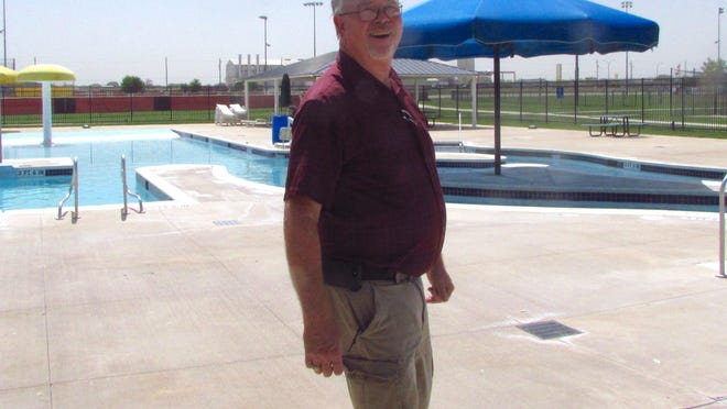 David Withers, parks and recreation director for the City of Brownwood, walks Tuesday at the Camp Bowie Family Aquatic Center, where minor maintenance is ongoing.