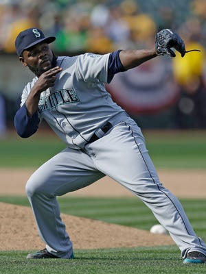 Seattle Mariners closer Fernando Rodney celebrates at the end of a game against the Oakland Athletics on Saturday, April 11, 2015, in Oakland, Calif.