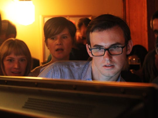 Tim Conroy watches from Motley Cow Cafe as Iowa City