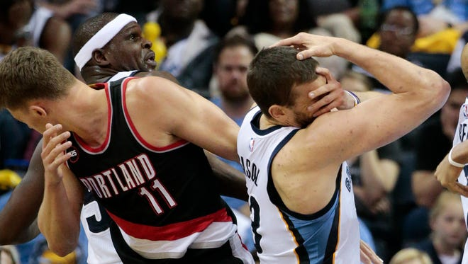 Portland Trail Blazers center Meyers Leonard (11) and Memphis Grizzlies center Marc Gasol, of Spain, right, recoil after colliding in the second half of Game 1 of an NBA basketball Western Conference playoff series Sunday, April 19, 2015, in Memphis, Tenn. The Grizzlies won 100-86.