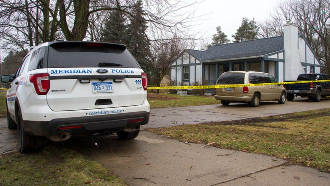 Meridian Township police investigate a double homicide in the 3300 block of East Lake Lansing Road Saturday, Jan. 21, 2017.