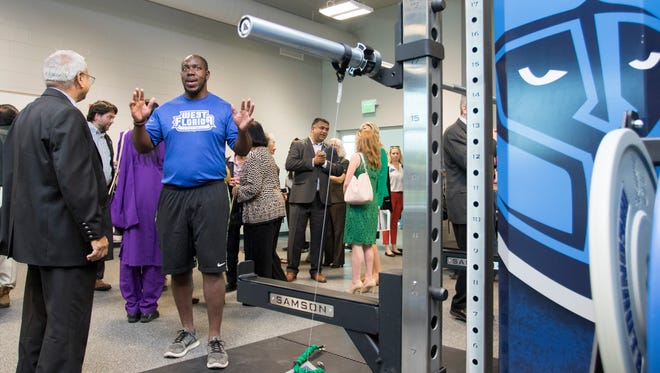 Mahadeb Kundu, left, listens as graduate assistant strength coach Demecrius Bailey gives a tour of the weight room facilities in the University Park Center at the University of West Florida in Pensacola on Friday, April 20, 2018.