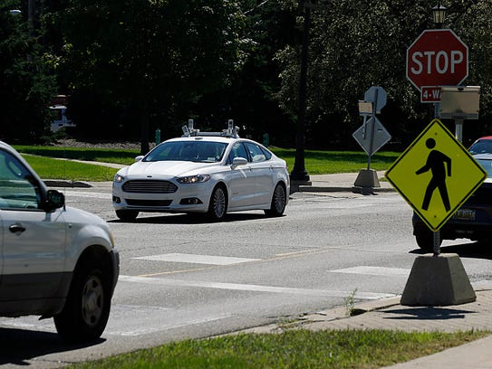 A Ford Fusion Hybrid autonomous test vehicle navigates