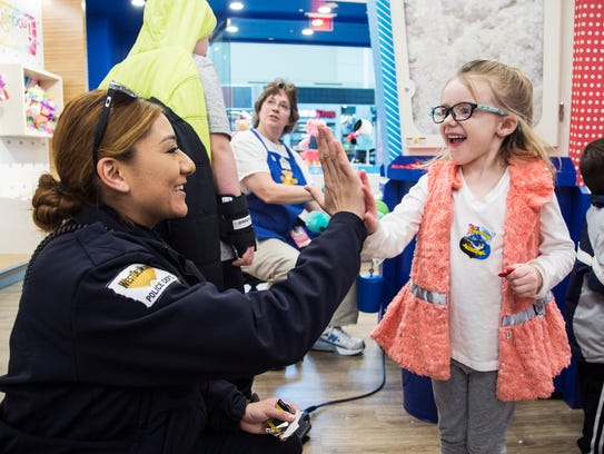 West Des Moines patrol officer Gladys Espitia gives