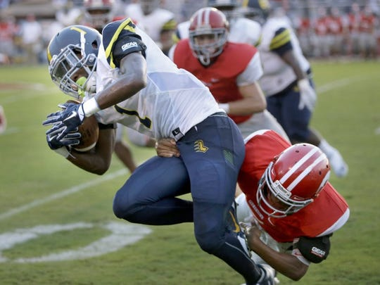 Lausanne sophomore running back Eric Gray tries to get free from Germantown defender.