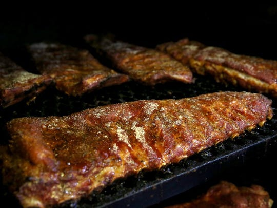 Ribs cook on the pit at Bodacious Bar-B-Q.