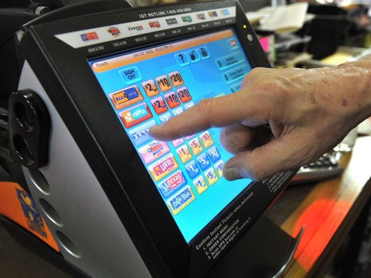 In this file photo, Victor Kocks, co-owner of Kocks Liquor demonstrates a Texas Lottery kiosk in his store on Kemp Boulevard. A winning Mega Millions ticket worth $30,000 was purchase in August 2019, at the Lucky Mart off Fairway Boulevard and the prize was never claimed. The prize is set to expire in February.