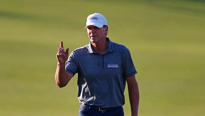 Madison's Steve Stricker acknowledges the gallery as he walks up to the 18th green during his victory in the Rapiscan Systems Classic on Sunday in Biloxi, Miss.